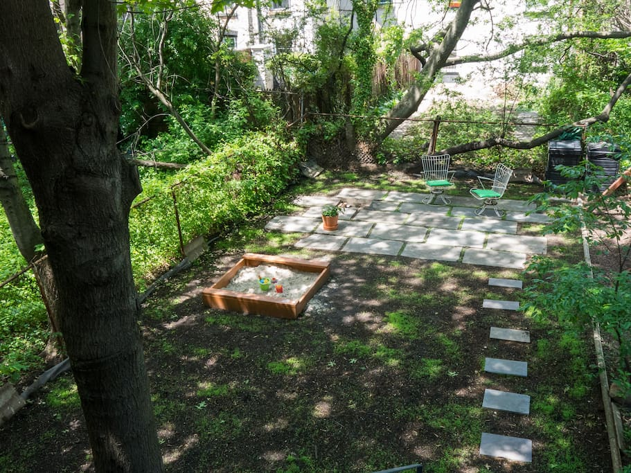 view to the garden with the bluestone patio - the freshly seeded clover is coming in nicely