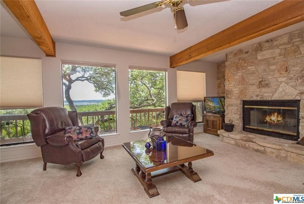 warm living room with FP and views
