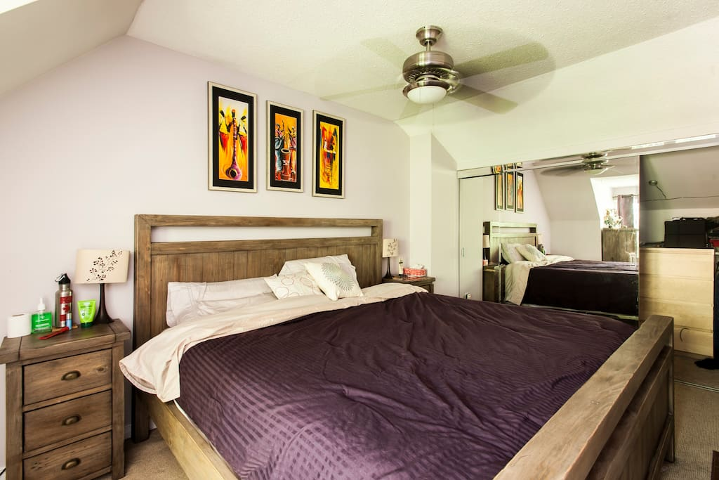 The master bedroom on the fourth floor features a cozy king sized bed