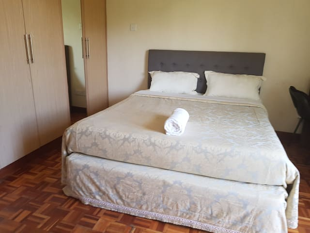 Queen bed with hotel quality bedding and comfortable mattress to ensure a good nights rest