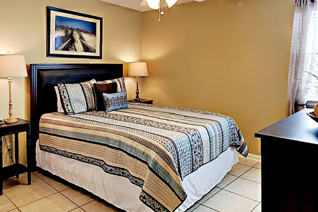 A queen bed in the master bedroom