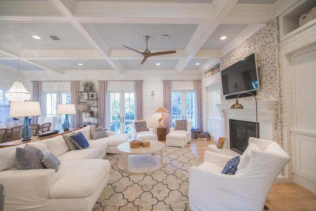 Open-concept first floor with wonderfully high coffered ceilings and light pouring in