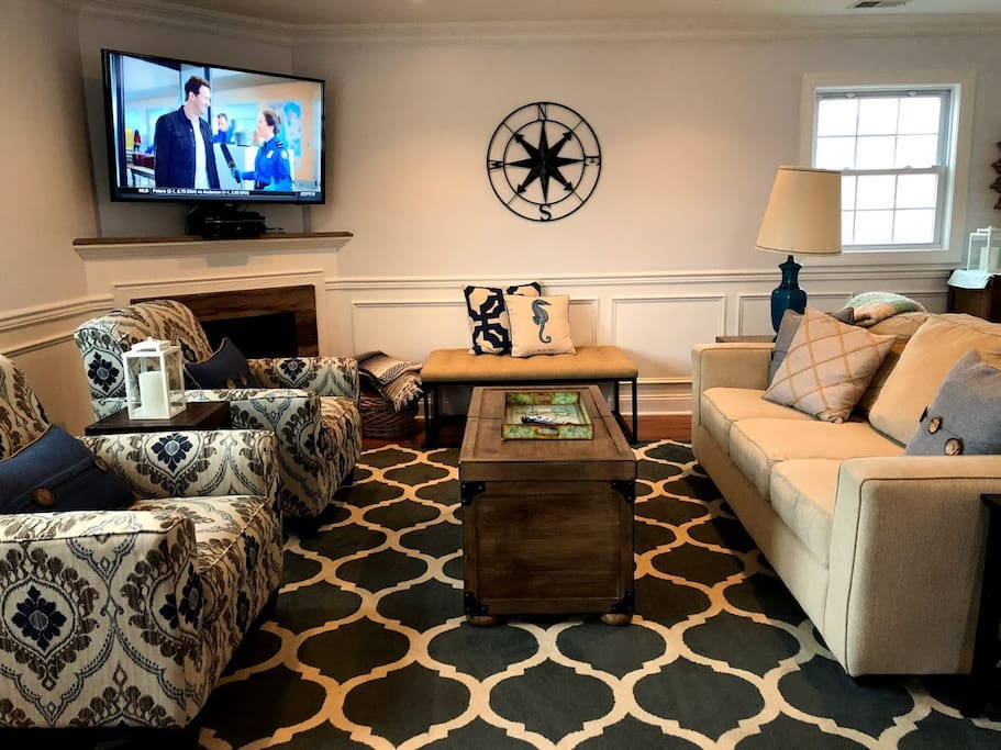 Bright, spacious main living room, equipped with large flat-screen SMART TV