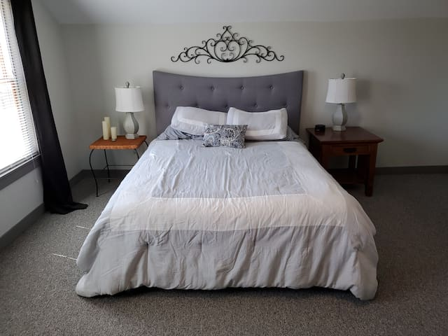 A comfortable queen bed is available in our main bedroom