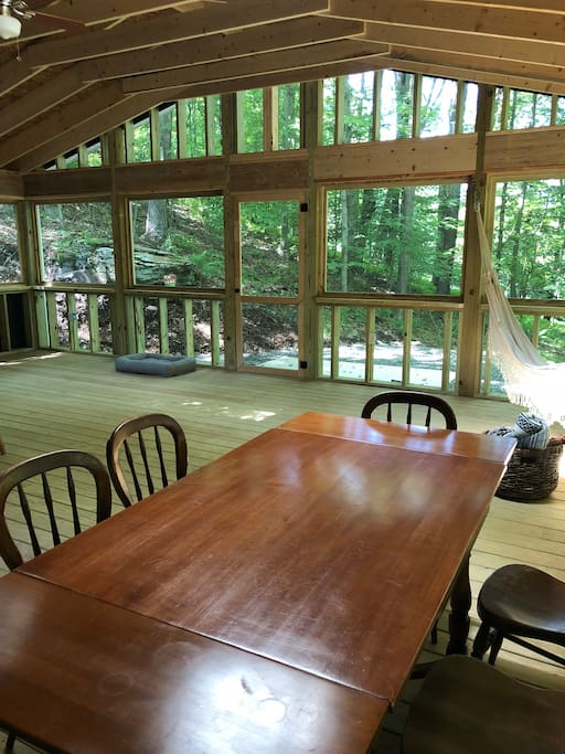 Have breakfast and dinner on the screened-in porch