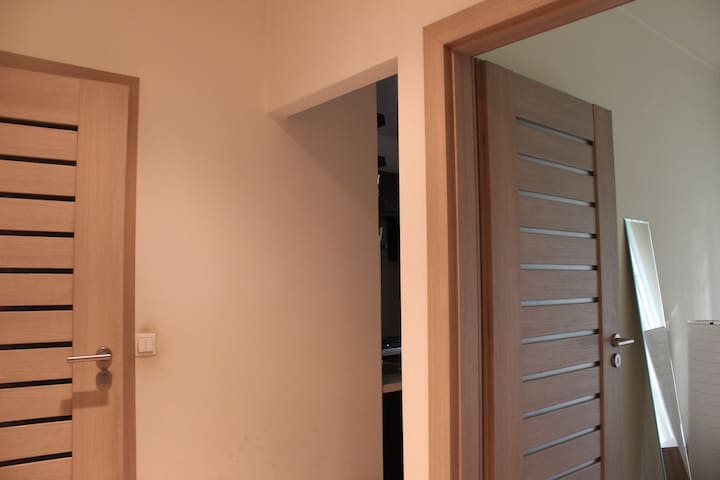 Entrance to the bathroom and smaller room.