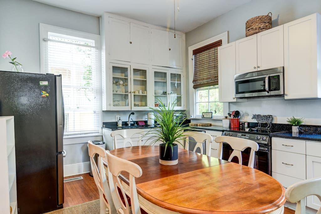 Fully equipped kitchen that looks onto the massive back yard!