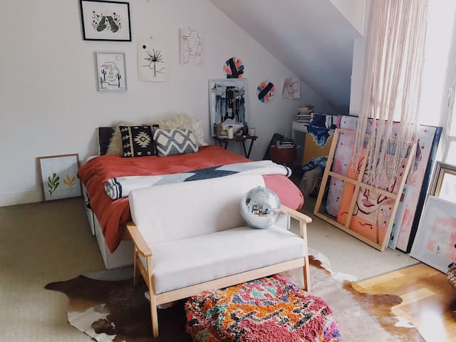 Sunny Art Filled Studio Apartment