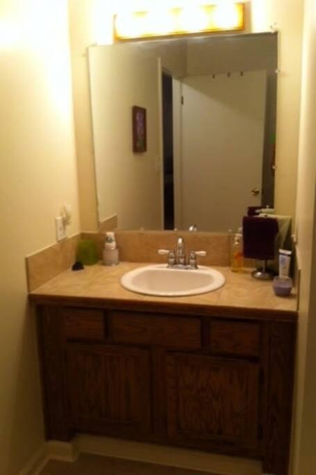 Vanity and sink in spacious bathroom