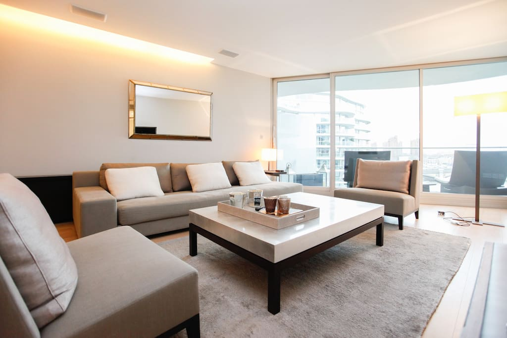 Elegant and comfortable living room with state of the art Crestron audio visual system and hidden speakers.
