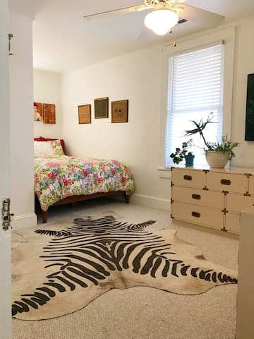 Plenty of dresser space and comfy nook with a queen -size bed in bedroom #1.