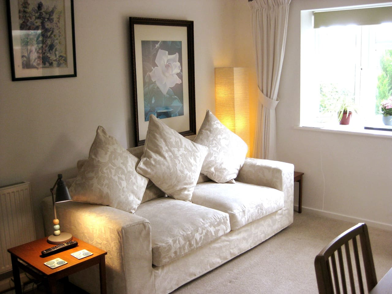Comfy sofa with reading lamps and coffee tables. A cosy way to unwind after a day's exploration.