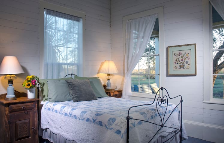 """The full sized bed in Francisca Alavez Suite.  Additional twin bed is on adjacent wall (out of view here), as is private bath.  Ms. Alavez earned the title """"Angel of Goliad"""" for her humanitarian acts surrounding the Battle of Coleto in Goliad."""