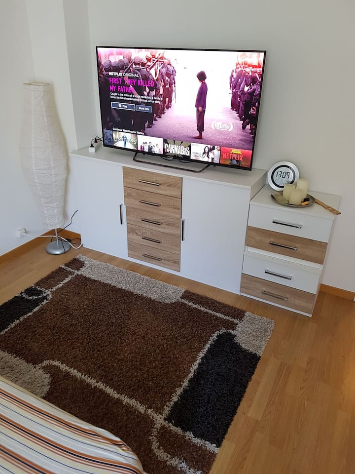 In your room 55inch flatscreen with Netflix, YouTube, Spotify...+additional storage