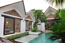 View on the three bungalows which you share the pool with