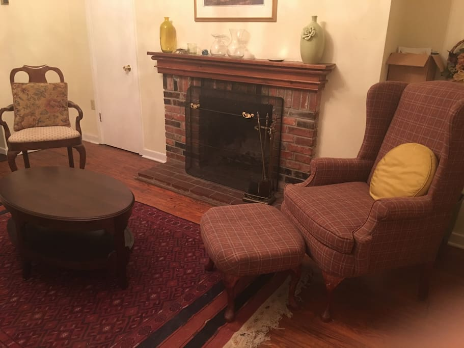 Shared sitting room with working fireplace