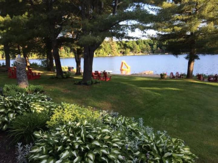 Charming Lakeside Retreat w Beach, Sauna & Hot Tub