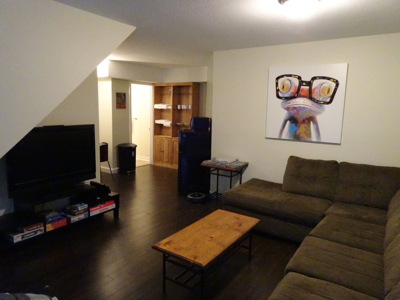 The main living space, complete with some board games to play!   There is no cable on the TV, but it is set up with Prime video and Netflix.
