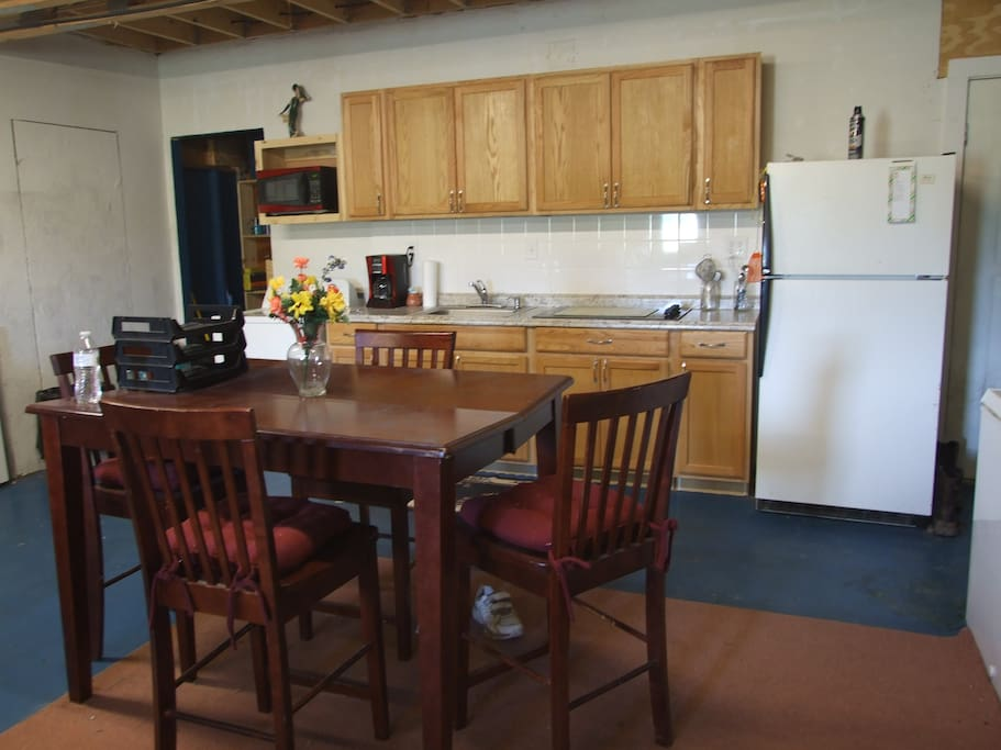 There is a shared kitchen and common room with washer & dryer & coffee maker