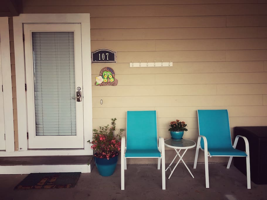The front door with a lounging area, and a large bin of beach supplies. Ask us for a list!