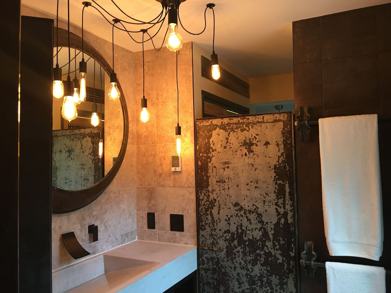 Fully Tiled Brick House Suite Industrial Bathroom with Edison Fixture
