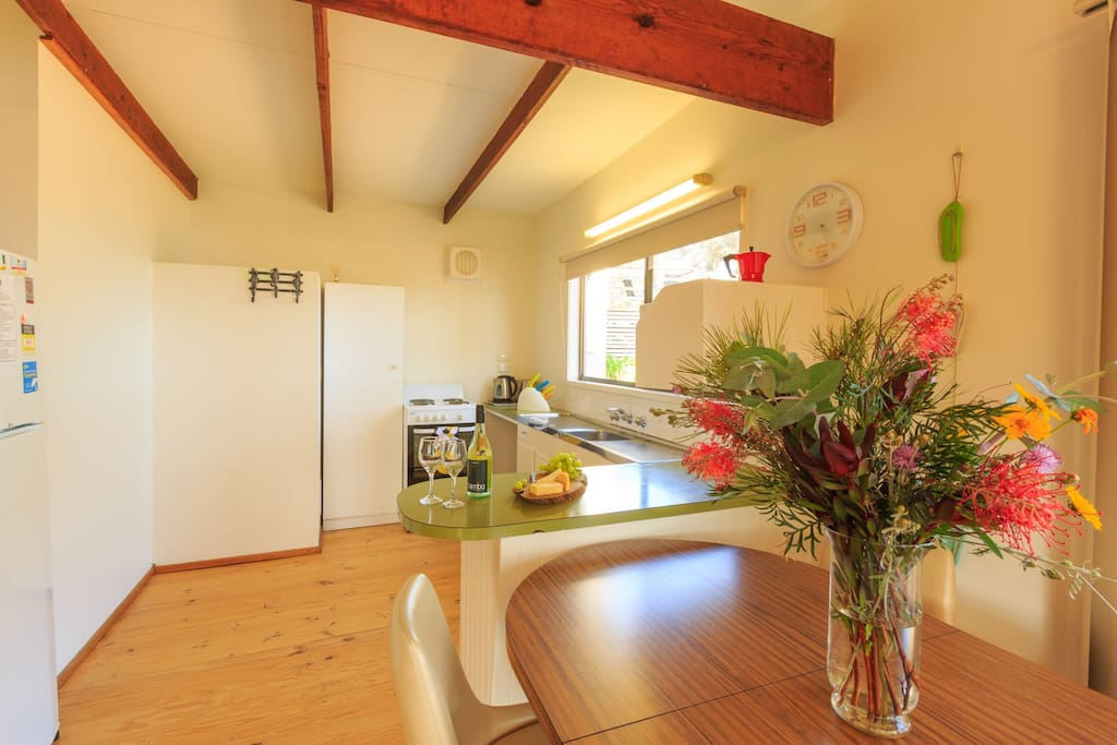 Open plan kitchen and dining area. Very clean and fully equipped to cook up a storm.