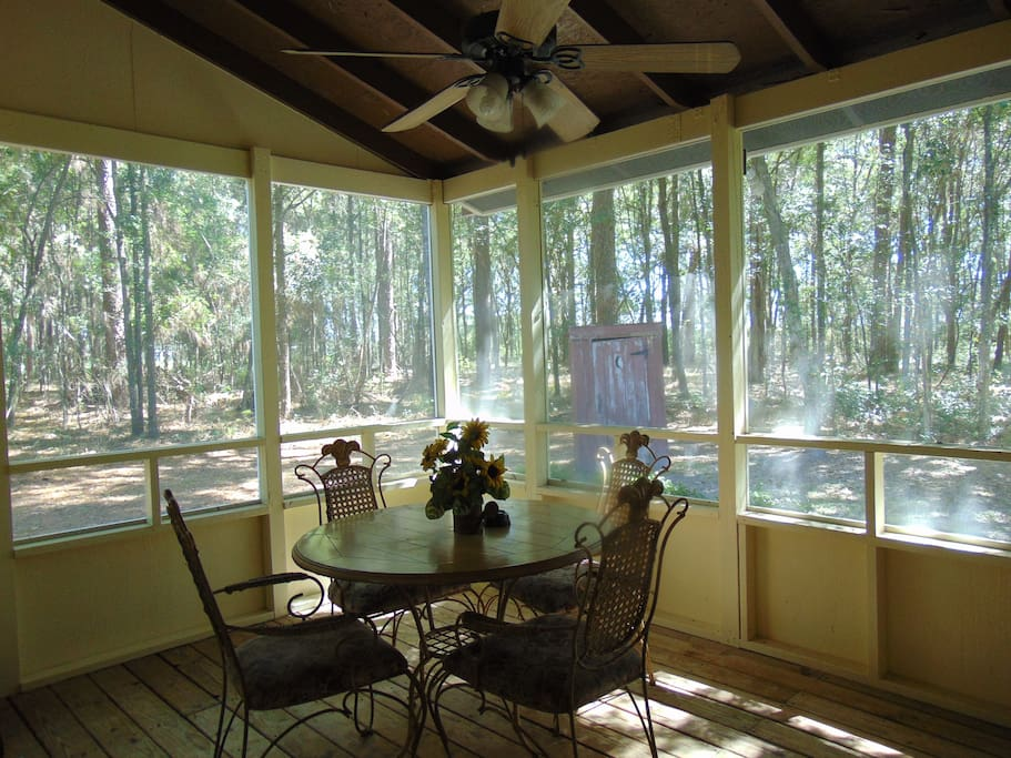 Back screened in porch with access to bbq grill.