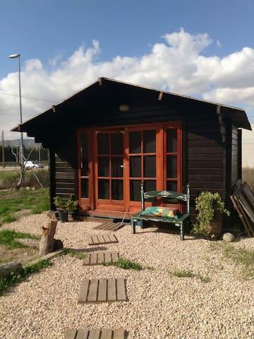 Cabaña de madera ideal para parejas.