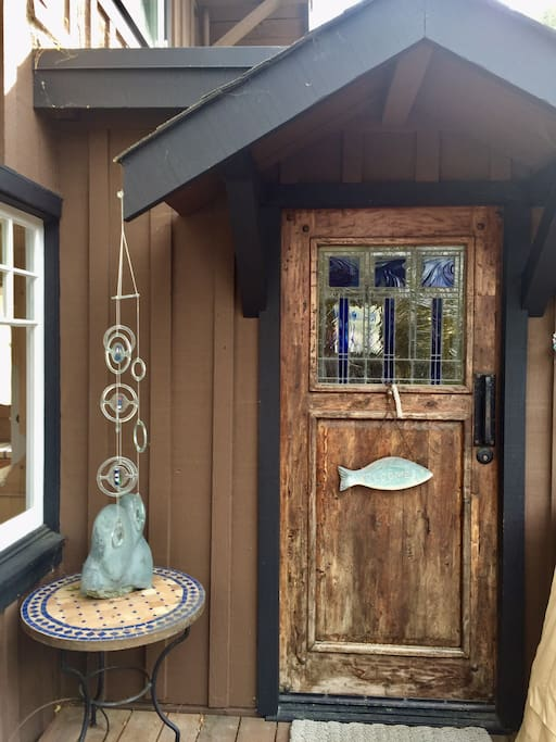 The front door was hand made by local artisans of woodworking and glass window by Masaoka Glass