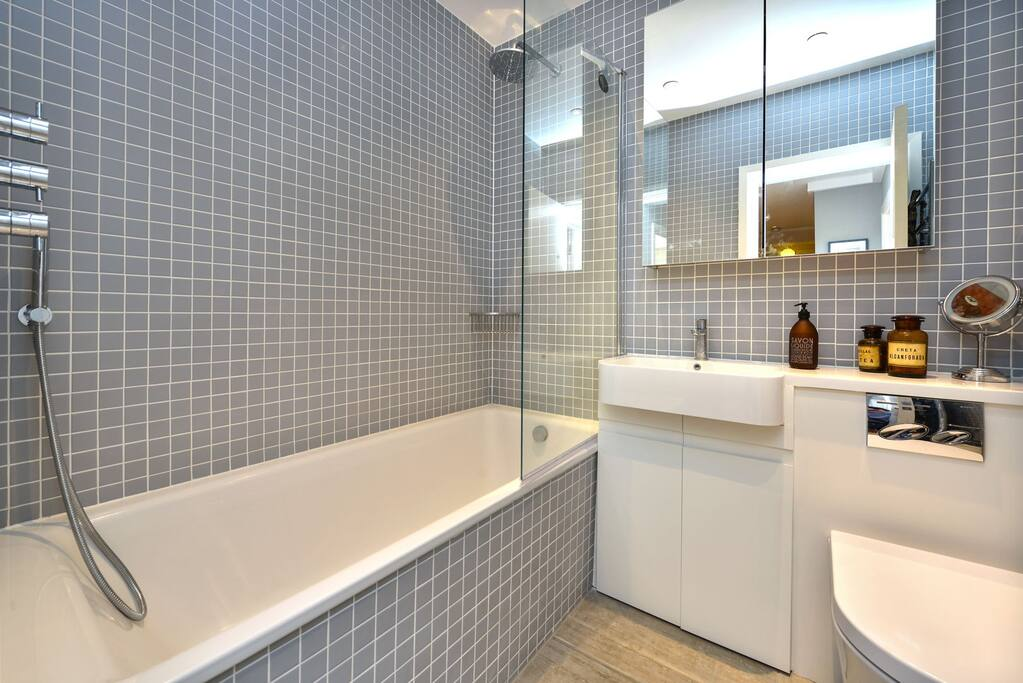 Luxury bathroom with waterfall shower.