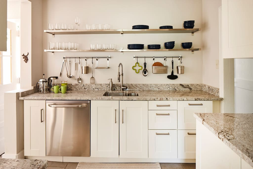 This house is perfect for entertaining.  Prepare a delicious meal in the well-stocked kitchen. Beautiful granite countertops make the kitchen easy to love.