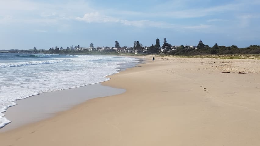 Shellharbour North beach. 8 minutes walk or 2 minutes drive. One of the best beaches. Bring your surfboard or fishing rod.