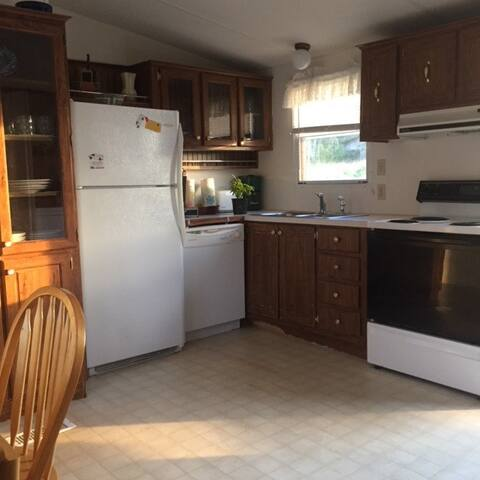 Fully furnished kitchen & dining (dishes, pots & pans, etc.)
