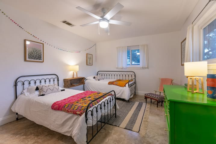 The second bedroom features two twin beds and one trundle.