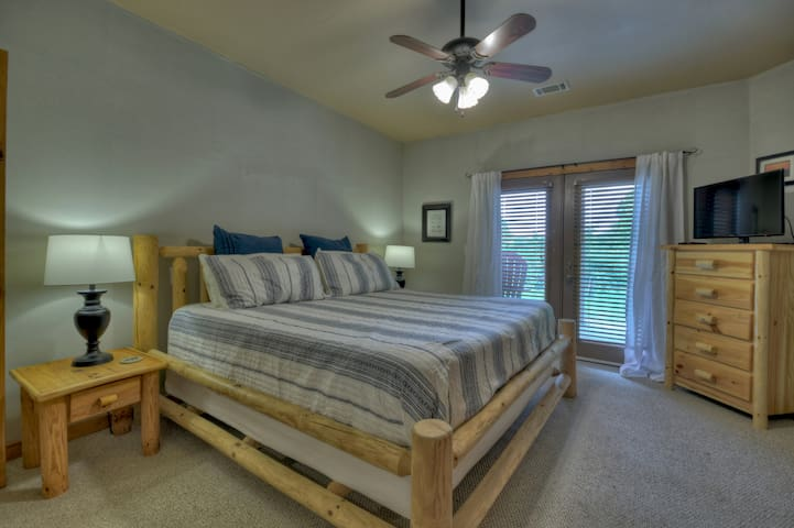 King bedroom on lower level, opens to patio with hot tub.