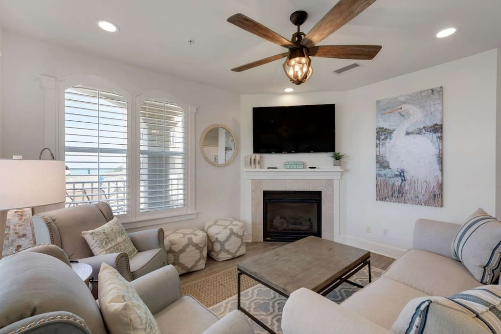 Living room features plenty of Plush Furnishings, as well as a Fireplace, Flat Screen TV, and views of the Gulf of Mexico