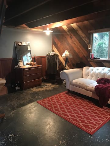 My current renter found the sofa, so that won't be there, but it gives you an idea of the space and what you could do with it, especially if you're here for an extended time.