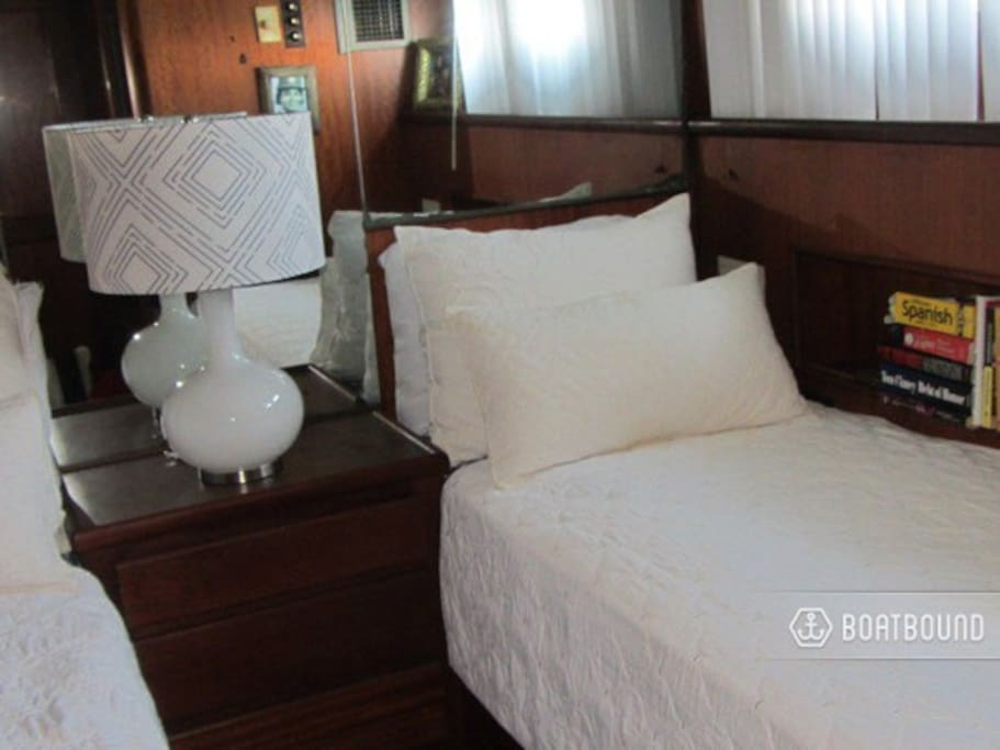 Comfortable twin beds with private bath and shower.