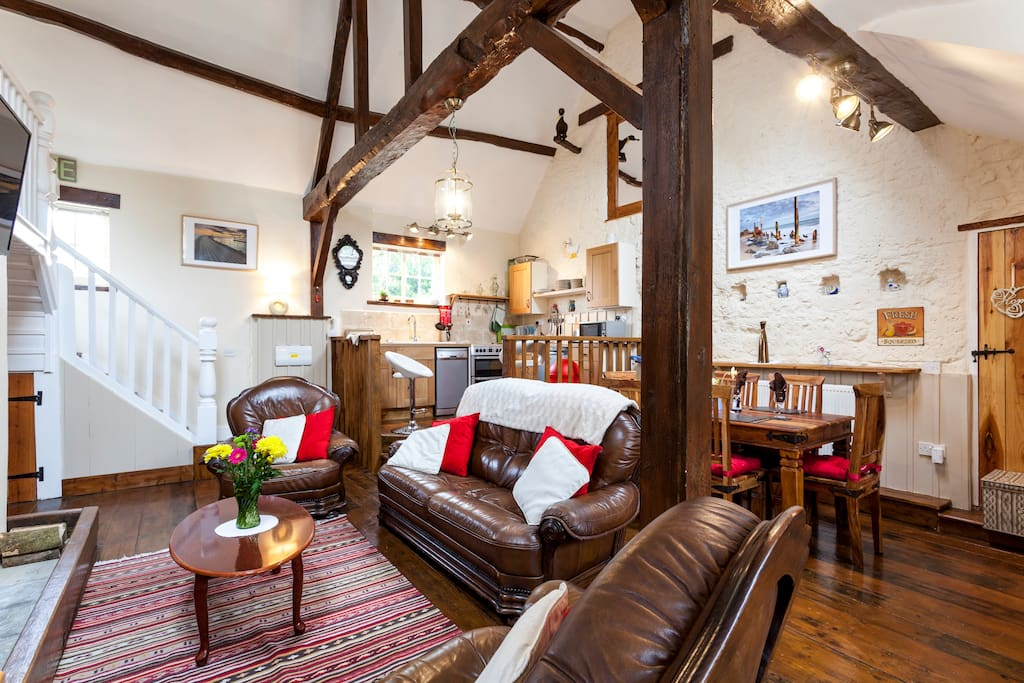 This is your main area comprising :  comfy lounge with original beams, diner and kitchen. Wooden floors throughout