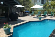 Listing for #2 of 2 bedroom rentals available. Outdoor space includes a heated pool, gas grill, and beautiful seasonal flowers.