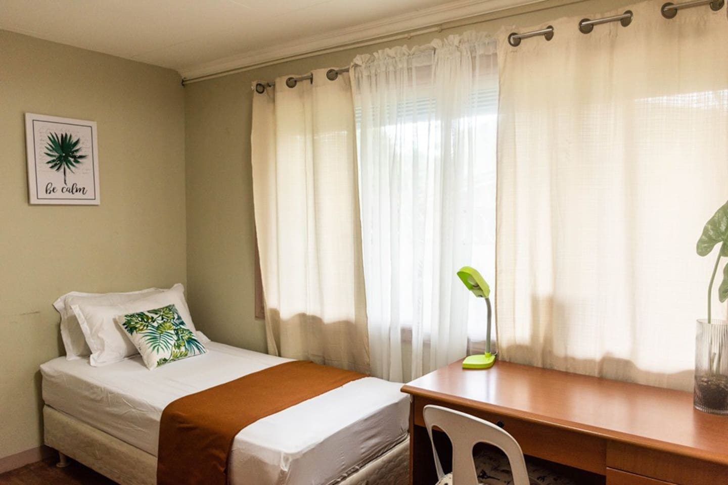 bed with two pillows, a desk, a chair and a wardrobe, an electric fan, and an air conditioner / 部屋には、ベッド、デスク、チェア、衣装棚、扇風機、そしてエアコンが備え付けられています。