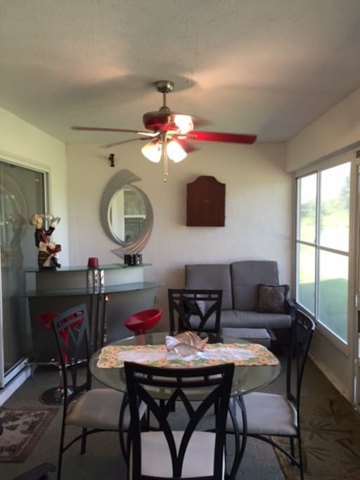 Enclosed porch with bar.