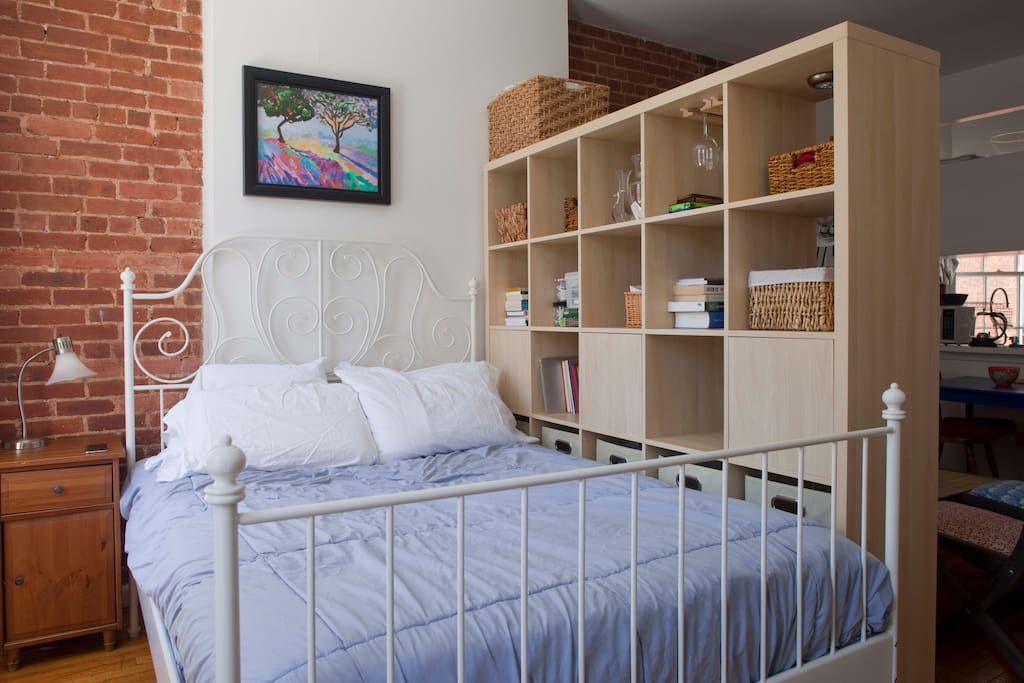 Full size bed with memory foam mattress pad and pillows. Bedding is changed between guests and therefore may vary slightly from photo shown, but is always comfy.