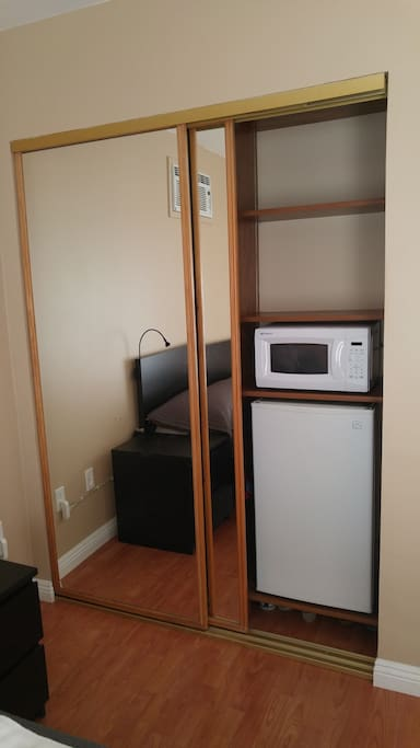 small fridge and microwave oven