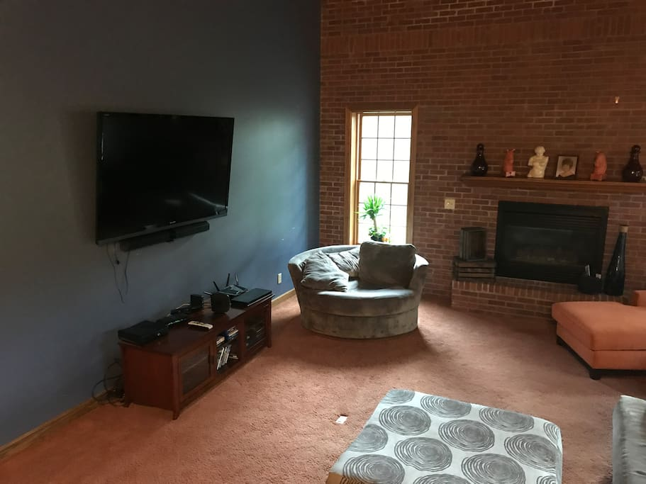 Living Room with Gas Fireplace and Pullout Queen Sectional