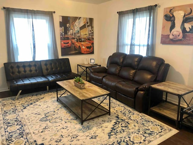 Living room with futon and reclining couch