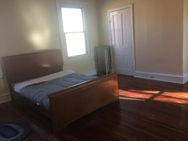Large, bright room, has wood floors