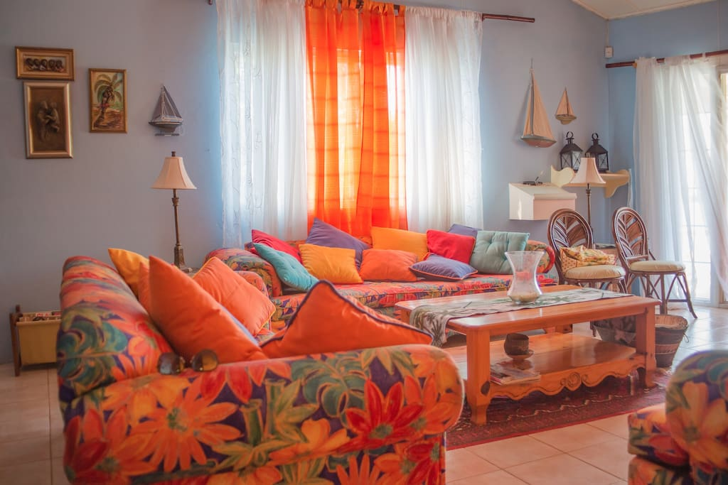 Beautiful and vibrant beach-side villa living room.
