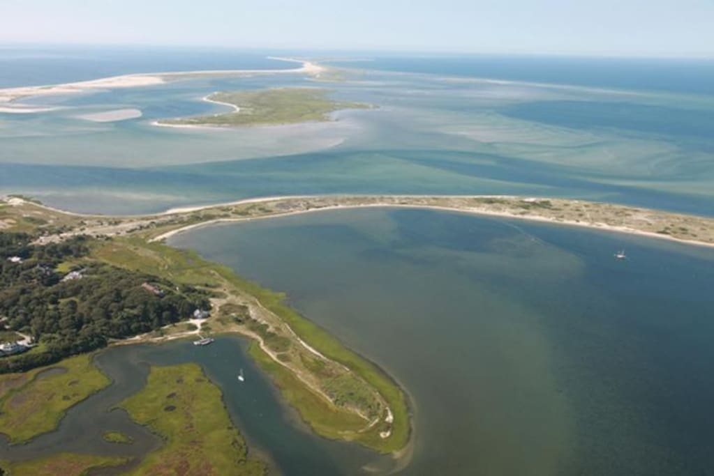 aerial view of the cove and Nantucket Sound where the property is located.House sits on the far left corner of cove.