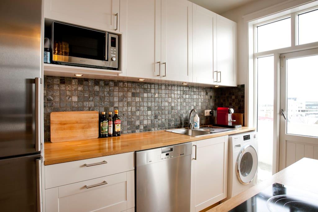 Microwave, nespresso machine, dishwasher and a washing machine.